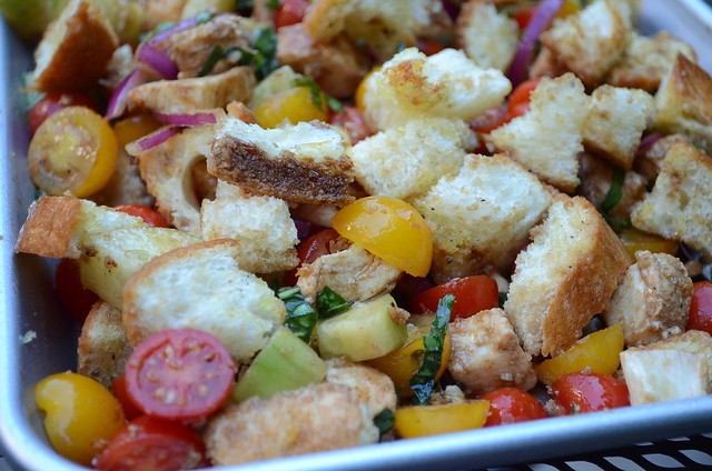 A close up view of the toasted bread and veggies.