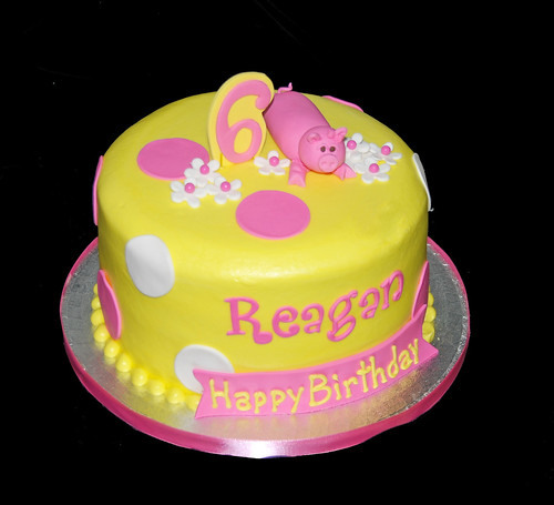 yellow and pink girly pig 6th birthday cake