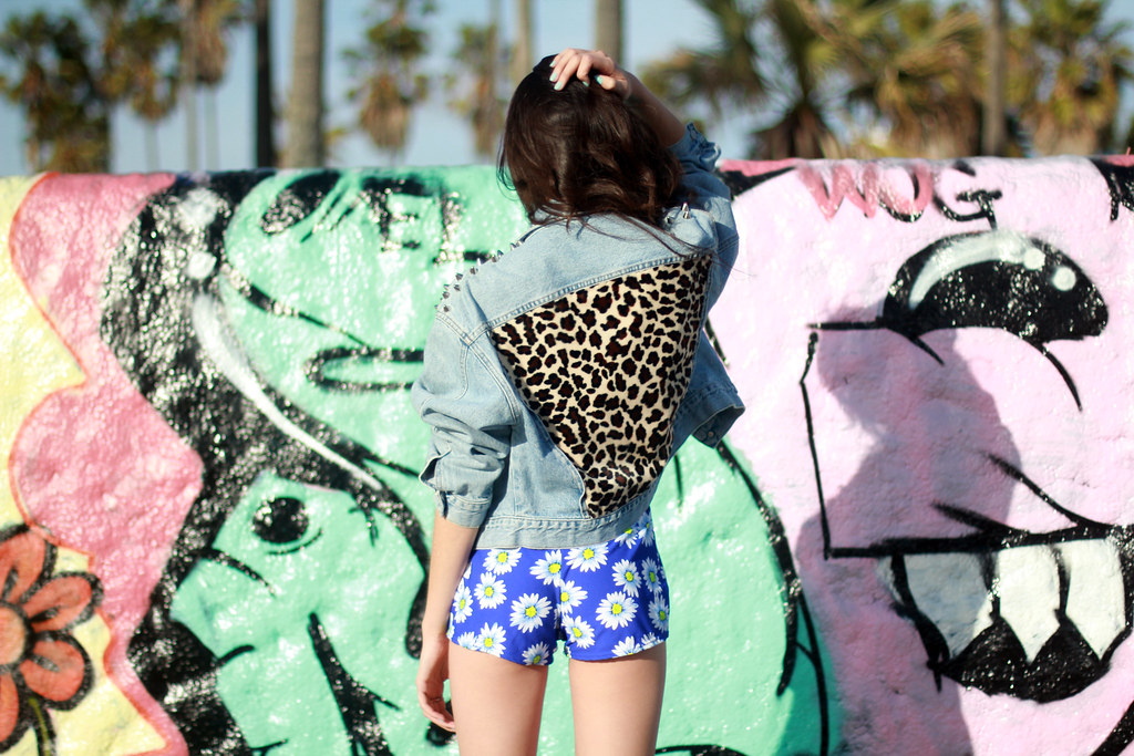 Tarte Vintage denim jacket with studs on shoulder and leopard back patch, vintage neon floral swimsuit top from shoptarte.com
