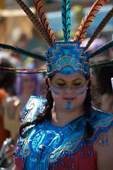 masque(0.0), performance art(0.0), festival(1.0), people(1.0), event(1.0), samba(1.0), costume(1.0),