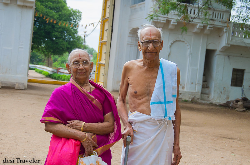 An old south indian couple arriving at sitaram bagh temple