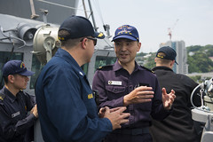 Cmdr. Jeff Heames, executive officer of USS Preble (DDG 88) speaks with Lt. Masaaki Mizunuma, navigator aboard JS Murasame (DD 101), as Preble departs Yokosuka, Japan, June 18. (U.S. Navy photo by Mass Communication Specialist 3rd Class Paul Kelly)