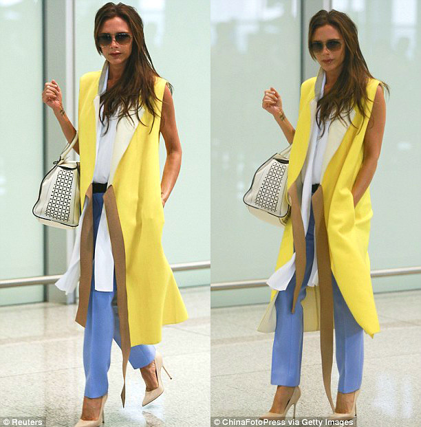 sleeveless white blouse, pastel blue trousers,  nude heels, Victoria Beckham's aviator sunglasses & bag from her Spring 2013 collection, Victoria Beckham in sleeveless yellow trench coat, yellow sleeves trench coat