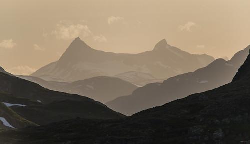 sunset snow mountains landscape jotunheimen gjende oppland