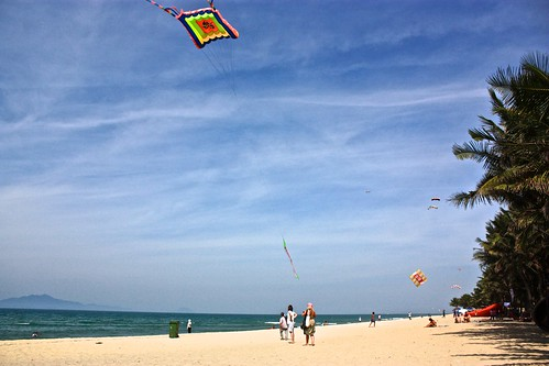 quite a kite flying scene on the beach in Hoi An