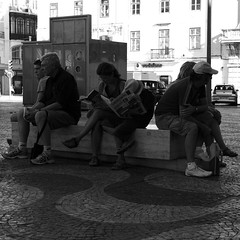 Tourists relaxing and reading