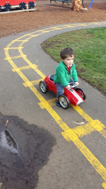 Zooming by on his 'bike'
