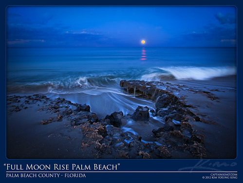 Full Moon Rising Over Beach Rocks During Crashing Waves