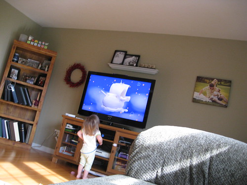 Audrey, wanting to get REALLYCLOSE to the tv (taken by Maggie)