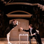Valmont's trusted accomplice Azolan (Seth Fisher) provides Valmont (Michael T. Weiss) with a key piece of correspondence in the Huntington Theatre Company's production of