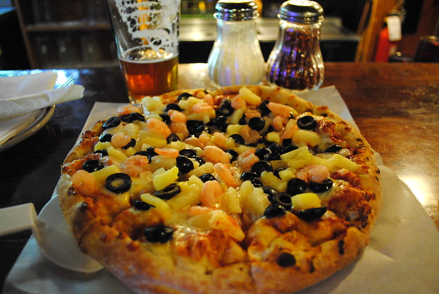 Oregon shrimp, black olive, and pineapple pizza at Zigzag Inn
