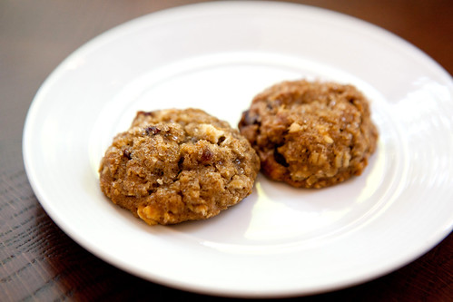 Mini oatmeal cherry and white chocolate cookies served with the check