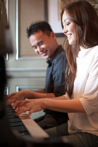 Image of couple playing piano