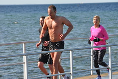 triathlon(0.0), open water swimming(0.0), sports(0.0), boating(0.0), duathlon(0.0), barechestedness(1.0), endurance sports(1.0), race(1.0), athlete(1.0),