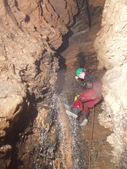 Helen climbing down a waterfall just after Pulpit Pitch Image