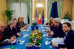 U.S. Secretary of State John Kerry sits with Italian Foreign Minister Paolo Gentiloni to discuss Mediterranean issues on December 2, 2016, before a bilateral meeting following an Italian-hosted multinational conference about Mediterranean issues at the Parco dei Principe Hotel in Rome, Italy. [State Department photo/ Public Domain]