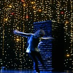 """Carol Mulroney (Ana Reeder) dances with abandon on the roof of her apartment building as city lights shimmer in the Huntington Theatre Company's World Premiere of Stephen Belber's """"Carol Mulroney"""" directed by Lisa Peterson at the Calderwood Pavilion. Part of the 2005-2006 season. Photo: T. Charles Erickson."""