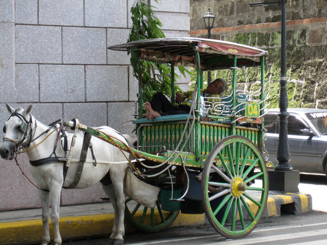 Waiting for customers in Intramuros