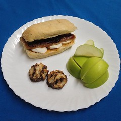 the baby is on the dining table so i wasnt able to do my usual newspaper pic. anyway, #dinner tonight is a hotlink #sausage with #sundried #tomato #pesto spread and #bufala #mozzarella sandwich with sliced #apples and #chocolate coated #macaroons. tastes