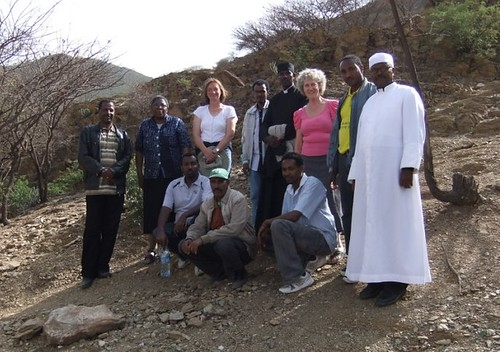Examining the new site are Winifred Ojo SSL (back row, second from left), Ruth Bradfield (back row, third from left), Margaret Healy SSL (back row, third from right) and the Bishop of Dawhan (back row, far right) with local surveyors and architects