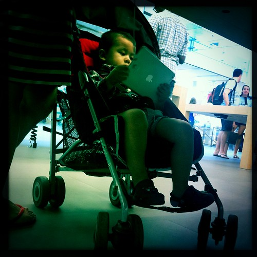 My nephew at the Apple Store, Soho