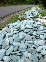 Sorted blue stones for sale at the side of the road