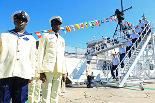 Members of the Nigerian Navy stand in formation as members of the U.S. Coast Guard disembark the decommissioned Coast Guard Cutter Gallatin during a ceremony in North Charleston, S.C., to transfer the ship to the Nigerian Navy Wednesday, May 7, 2014. Nigeria's Minister of State for Defence Musiliu Obanikoro said the ship will strengthen Nigeria's capability to safeguard the country's waters and offshore resources. (U.S. Coast Guard photo by Petty Officer 1st Class Lauren Jorgensen)