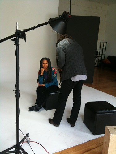 Sharan, sitting serenely, as she's being photographed by Lamont