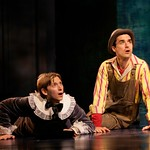 Moth (Jeremy Beck, l.) and Costard (Tommy Schrider) listen to a feats in the Huntington Theatre Company's production of Shakespeare's comedy,