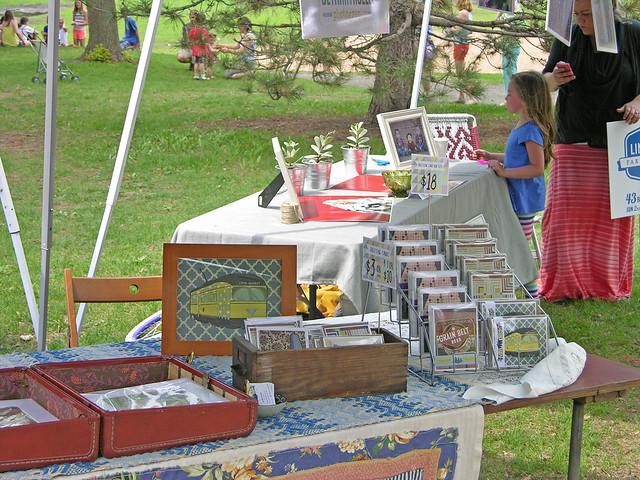 2013 Linden Hills Festival cards on table