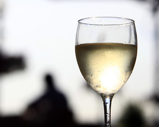 Glass of White Wine at an outdoor bar.
