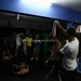 <p>Ehtisham Karim is shown at the Synergy MMA Academy in Lahore, Pakistan. His hand is being raised after his victory, while his opponent is lying on the mat recovering from the defeat.</p>