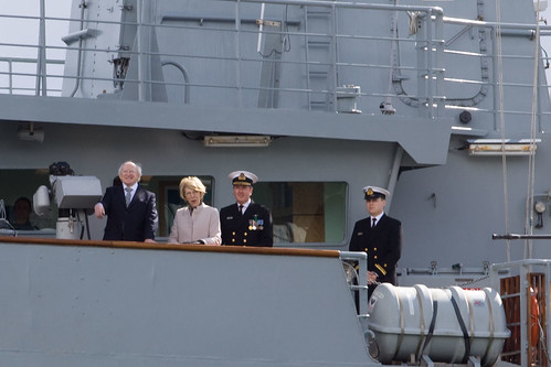President Higgins conducts fleet review