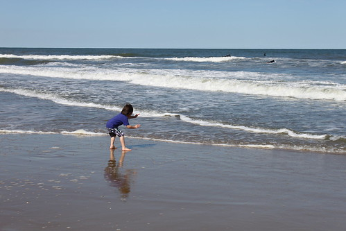 Jack karate chopping the ocean waves in Va. Beach