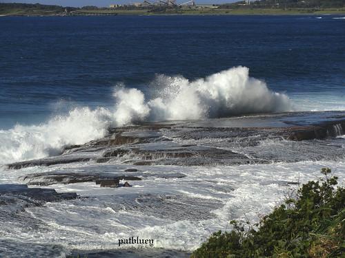 Waves crashing onto rocks at Barrack Point
