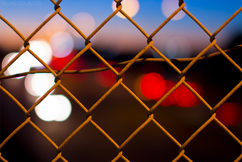 lighting street city morning blue light red urban orange usa white black color geometric colors yellow boston composition contrast sunrise canon fence ma photography 50mm dawn lights early twilight lowlight aperture streetlight warm brighton dof unitedstates bokeh streetlights circles massachusetts horizon newengland sigma chainlink link bluehour distance streetscape foreground urbanlandscape brightonma bokehphotography gregdubois gregduboisphotography