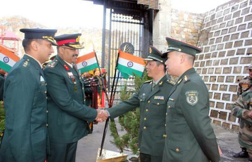 Indian Army officers greet their Chinese counterpart at Natu La border on Monday on the occasion of Republic Day of China on October 1, 2013 by Chindits
