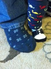outdoor shoe(0.0), limb(0.0), leg(0.0), human body(0.0), pattern(1.0), wool(1.0), footwear(1.0), shoe(1.0), sock(1.0), blue(1.0),