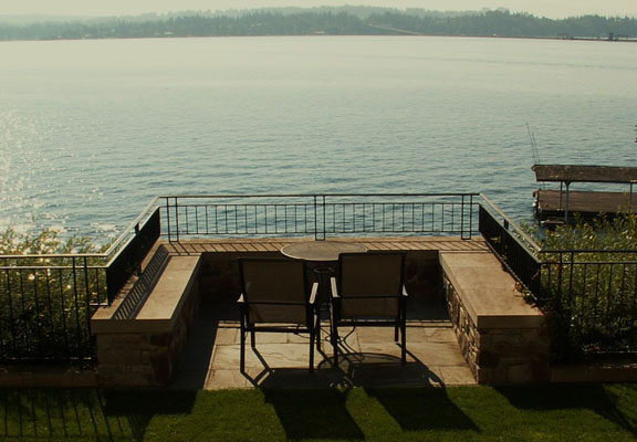 The home's upper terrace offers views of Lake Washington and a floating bridge.