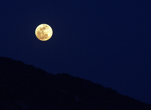 Full moon over San Gabriel Mountain ridge by JulieAndSteve