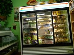 slot machine(0.0), fast food(0.0), machine(1.0), display case(1.0), food(1.0),