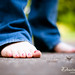 192: Bare feet and blue jeans