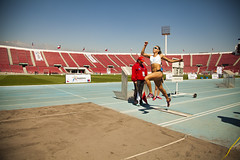 sprint(0.0), athletics(1.0), track and field athletics(1.0), jumping(1.0), sport venue(1.0), sports(1.0), long jump(1.0), race track(1.0), stadium(1.0), athlete(1.0),
