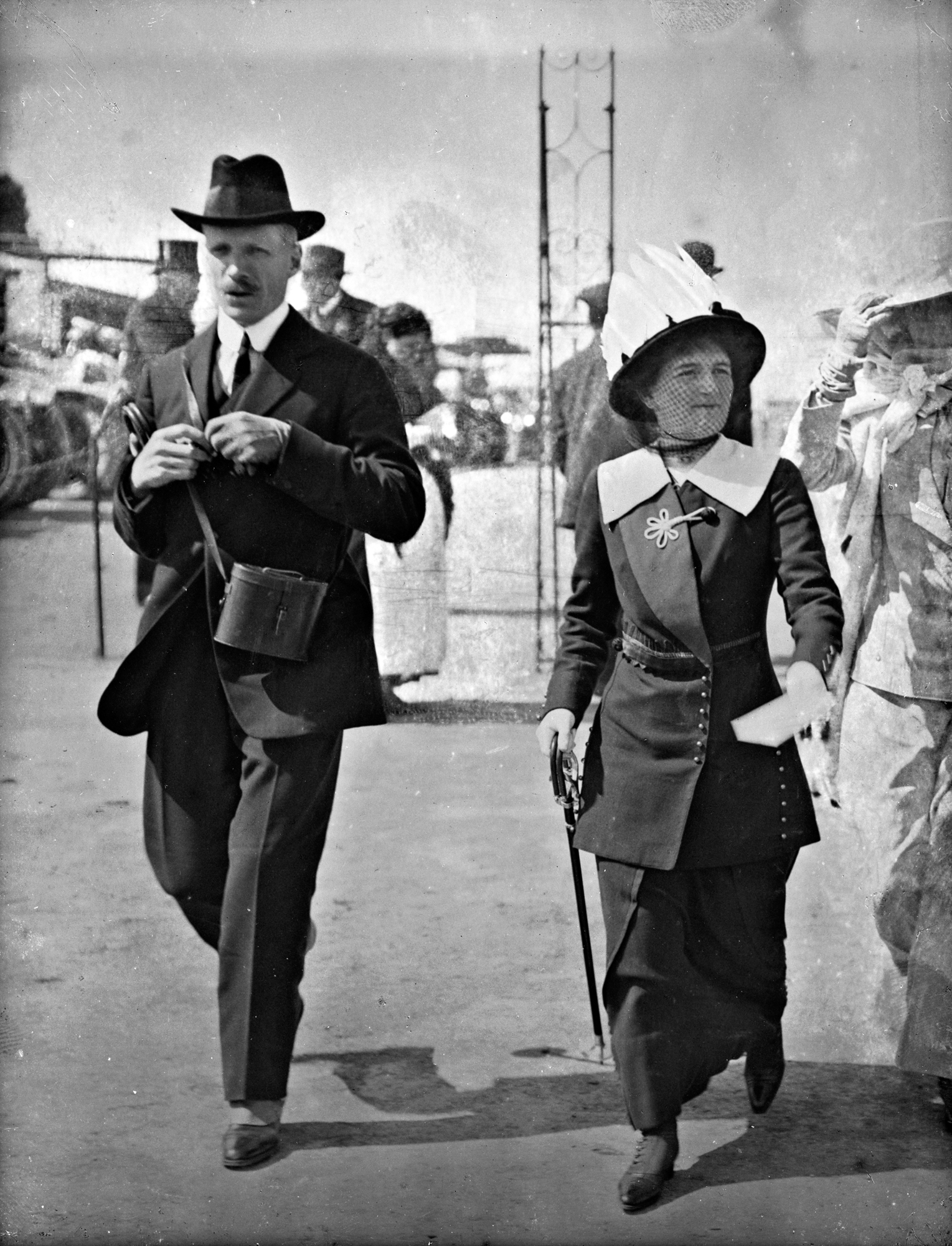 Spit, spot, spats, striding strongly!  Mr. and Mrs. Herbert Goff at the races!