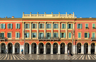 Image of Place Masséna. france sunny colorful building italianarchitecture arches people red architecture shutters windows yellow placemasséna nice placemassã©na