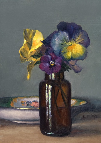Pansies with saucer