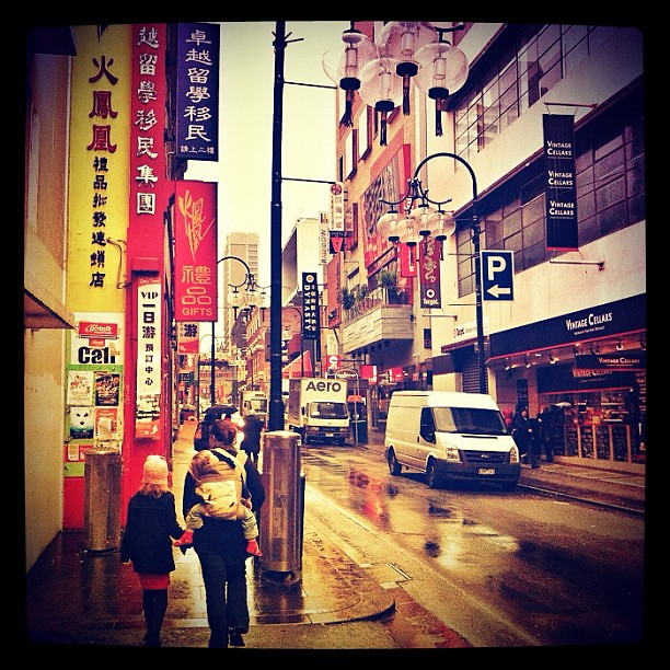 Rainy day baby-wearing in downtown Chinatown. #babywearing #melbourne