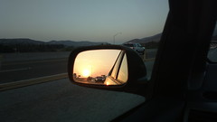 Sun setting in my mirror while traveling east on the 91 #LeavingLA #StuckinTraffic