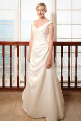 bridesmaid(0.0), bride(1.0), bridal party dress(1.0), bridal clothing(1.0), textile(1.0), gown(1.0), clothing(1.0), cocktail dress(1.0), woman(1.0), female(1.0), satin(1.0), wedding dress(1.0), dress(1.0),