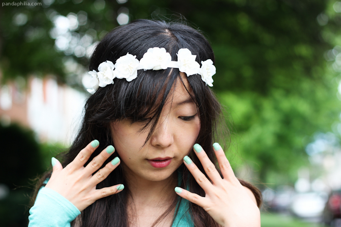 flower crown and mint nail polish